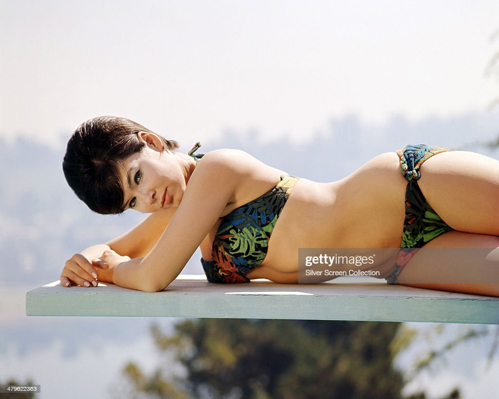 American actress <a gi-track='captionPersonalityLinkClicked' href=/galleries/search?phrase=Yvonne+Craig&family=editorial&specificpeople=1658641 ng-click='$event.stopPropagation()'>Yvonne Craig</a> wearing a bikini and lying on a diving board, circa 1965.