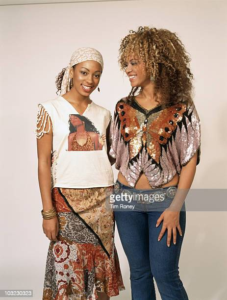 American actresses and singers Solange Knowles and her sister Beyonce Knowles June 2002