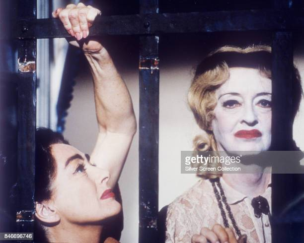 American actresses Joan Crawford as Blanche Hudson and Bette Davis as Jane Hudson in the thriller/horror movie 'What Ever Happened to Baby Jane' 1962