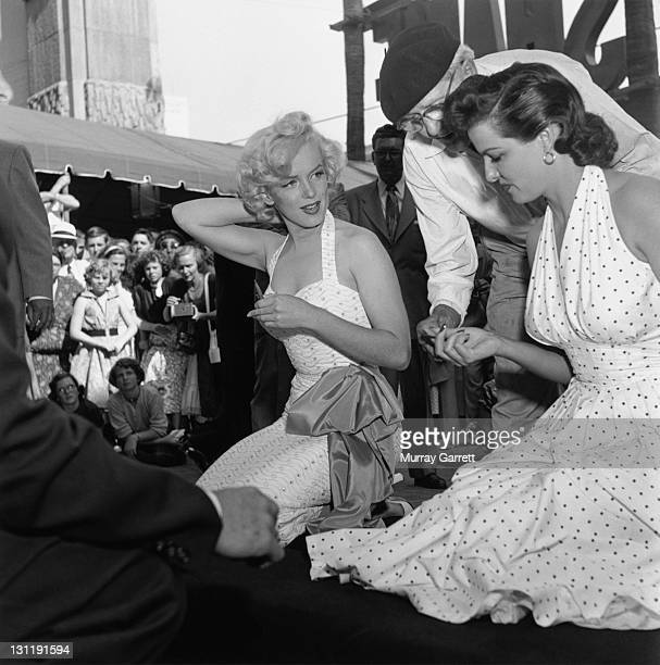 American actresses Marilyn Monroe and Jane Russell with fans outside Grauman's Chinese Theatre Hollywood California 1953
