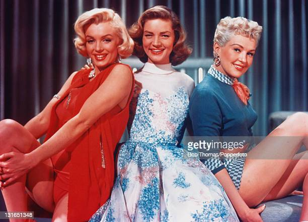 American actresses Marilyn Monroe Lauren Bacall and Betty Grable in a promotional portrait for 'How To Marry A Millionaire' directed by Jean...