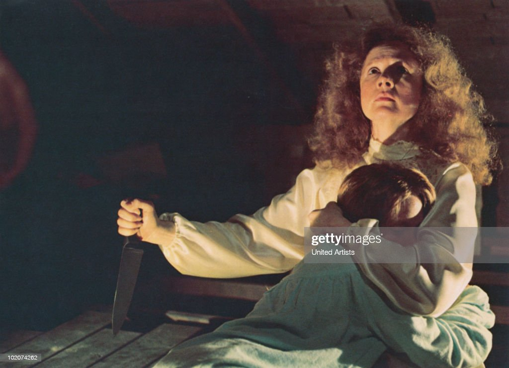 American actresses Piper Laurie (with knife) and Sissy Spacek star in the film 'Carrie', 1976.