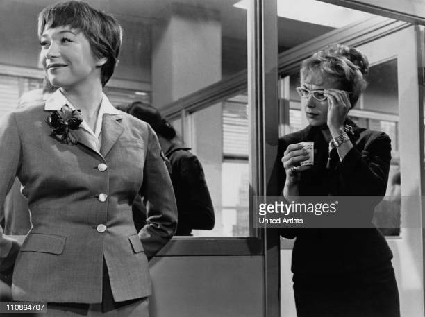 American actresses Shirley MacLaine and Edie Adams in a scene from 'The Apartment' directed by Billy Wilder 1960