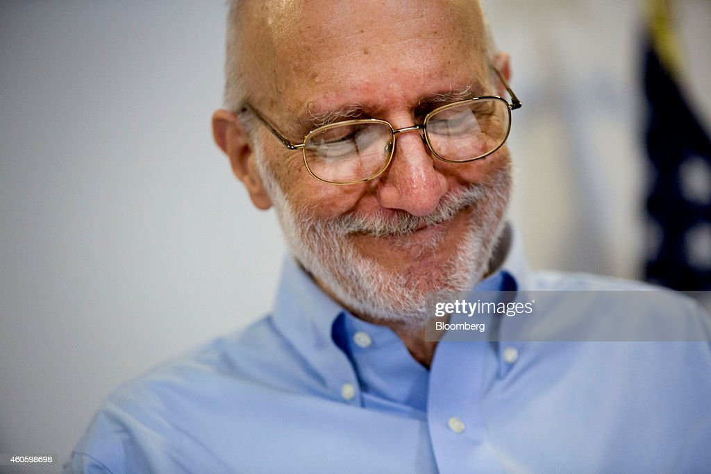 American aid worker Alan Gross, a former Cuban prisoner released on humanitarian grounds, pauses while speaking at a news conference in Washington, D.C., U.S., on Wednesday, Dec. 17, 2014. President Barack Obama said the U.S. will end more than half a century of isolation of Cuba, initiating talks to resume diplomatic relations, opening a U.S. embassy in Havana and loosening trade and travel restrictions on the nation. Photographer: Andrew Harrer/Bloomberg via Getty Images