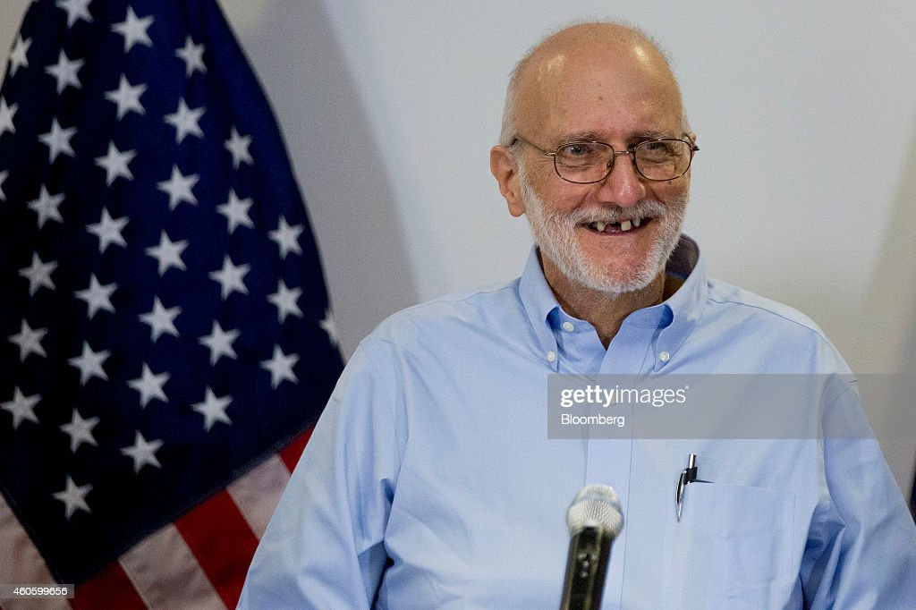 American aid worker <a gi-track='captionPersonalityLinkClicked' href=/galleries/search?phrase=Alan+Gross&family=editorial&specificpeople=6994459 ng-click='$event.stopPropagation()'>Alan Gross</a>, a former Cuban prisoner released on humanitarian grounds, smiles during a news conference in Washington, D.C., U.S., on Wednesday, Dec. 17, 2014. President Barack Obama said the U.S. will end more than half a century of isolation of Cuba, initiating talks to resume diplomatic relations, opening a U.S. embassy in Havana and loosening trade and travel restrictions on the nation. Photographer: Andrew Harrer/Bloomberg via Getty Images