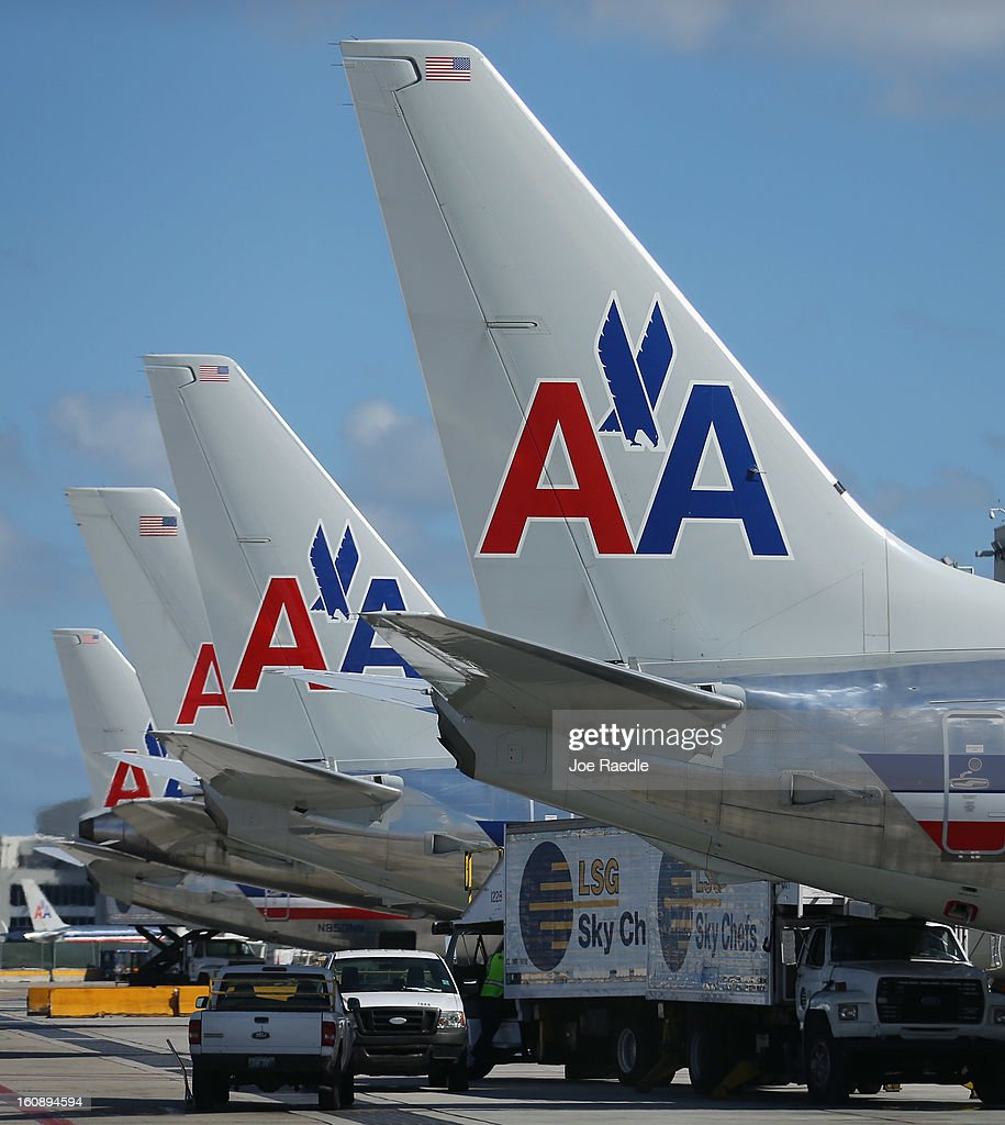 American Airline planes are seen at the Miami International Airport on February 7, 2013 in Miami, Florida. Reports indicate that a deal between American Airlines and US Airways to merge may be set for early next week. If the deal goes through it would create the world's biggest airline.