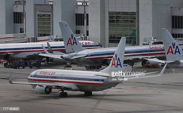 American Airlines aircraft sit on the tarmac at Miami International Airport as MiamiDade County Mayor Carlos A Gimenez and Airport Aviation Director...