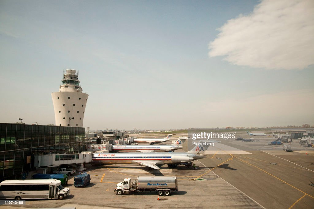 American Airlines Inc McConnell Douglas MD82 planes front and McConnell Douglas MD83 planes center and back stand by gates at LaGuardia Airport in...
