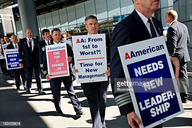 American Airlines Inc pilots and supporters picket at O'Hare International Airport in Chicago Illinois US on Thursday Sept 20 2012 American Airlines'...