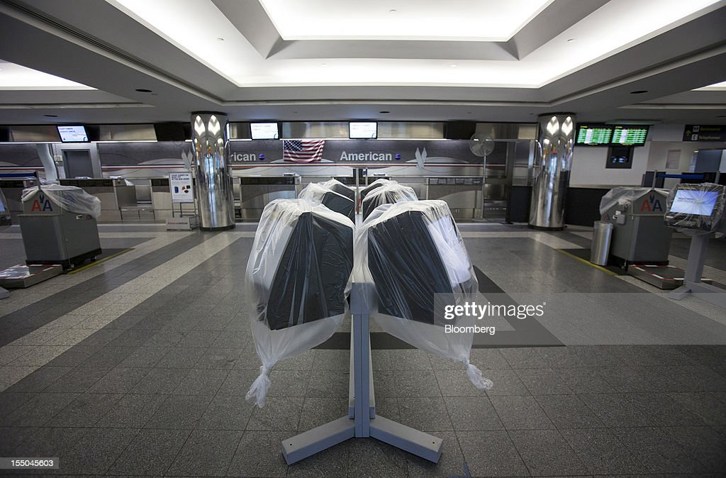 American Airlines Inc. ticketing kiosks stand wrapped in plastic at LaGuardia Airport in New York, U.S., on Monday, Oct. 29, 2012. Hurricane Sandy disrupted air travel across the U.S., grounding more than 9,500 flights today and tomorrow as the storm barreled toward the northeast and forced the region's major airports to suspend operations. Photographer: Scott Eells/Bloomberg via Getty Images