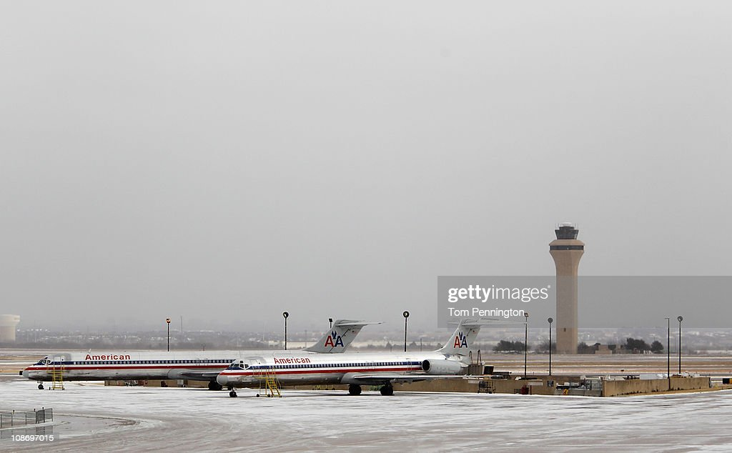 American Airlines jets sit idle after an overnight ice storm forced the closure of DFW International Airport on February 1, 2011 in Dallas, Texas. A major ice storm hit the Dallas/Fort Worth area overnight days before Super Bowl XLV is to be be held in Arlington, Texas.