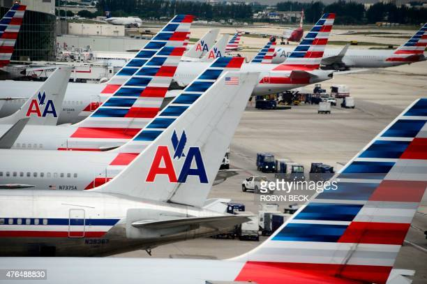 American Airlines passenger planes are seen on the tarmac at Miami International Airport in Miami Florida June 8 2015 AFP PHOTO/ROBYN BECK
