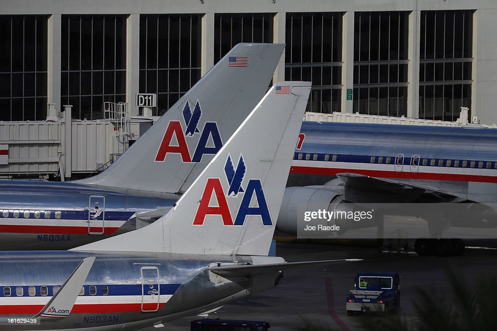 American Airlines planes are seen on the tarmac at the Miami International Airport on February 12, 2013 in Miami, Florida. Reports indicate that a deal between American Airlines and US Airways to merge is set to be announced as early as tomorrow. If the deal goes through it would create the world's biggest airline.