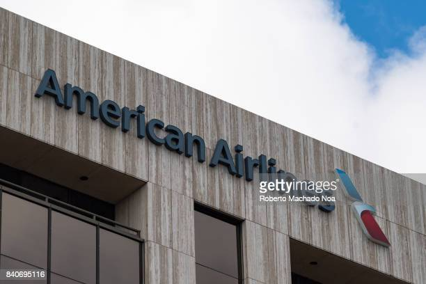 American Airlines sign and logo on top of a Miami city modern building