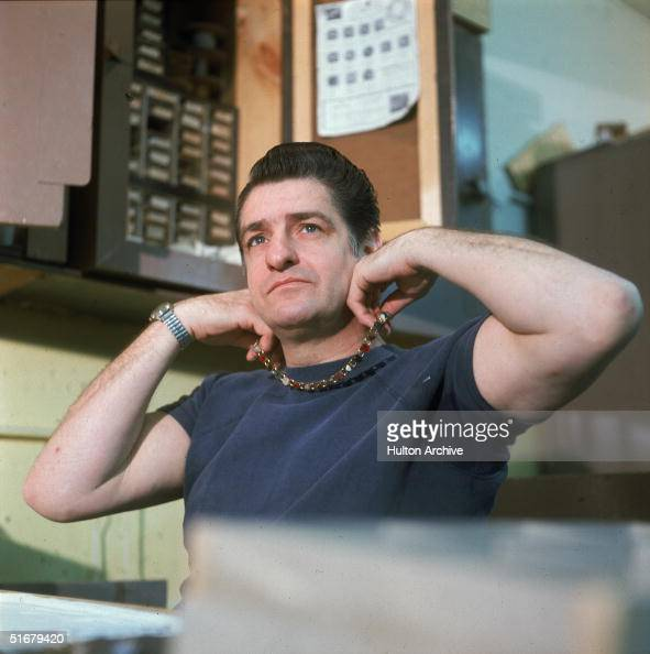 American Albert DeSalvo holds one of the necklaces he made while in prison up to his neck at Walpole State Prison South Walpole Massachusetts early...