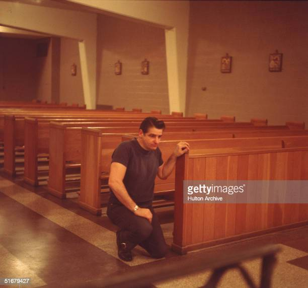 American Albert DeSalvo prays in the chapel at Walpole State Prison South Walpole Massachusetts early 1970s DeSalvo is the alleged Boston Strangler a...