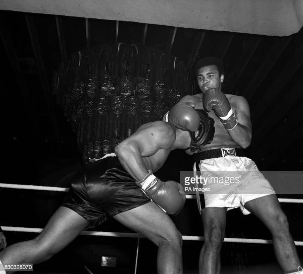 American Alonso Johnson ducks away from Muhammad Ali during exhibition bouts for ladies night at the London Hilton 17/01/02 Ali celebrates his 60th...