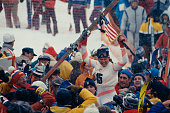 American alpine skier Debbie Armstrong is lifted by spectators following her gold medal victory in the women's giant slalom at the 1984 Sarajevo...