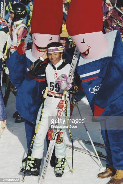 American alpine skier Seba Johnson of the Virgin Islands team pictured posing with mascots during competition to finish in 37th place in the Women's...