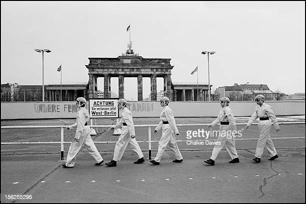 American alternative rock group Devo marching past the Brandenburg Gate West Berlin West Germany 1978