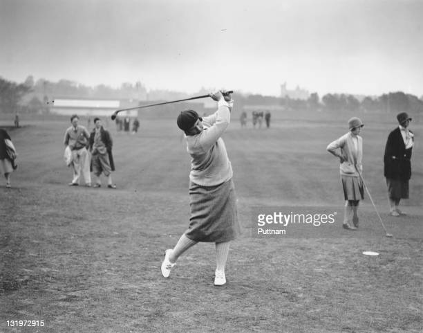 American amateur golfer Marion Hollins drives off during the 2nd day of the Ladies Open Golf Championship at St Andrews Scotland 15th May 1929