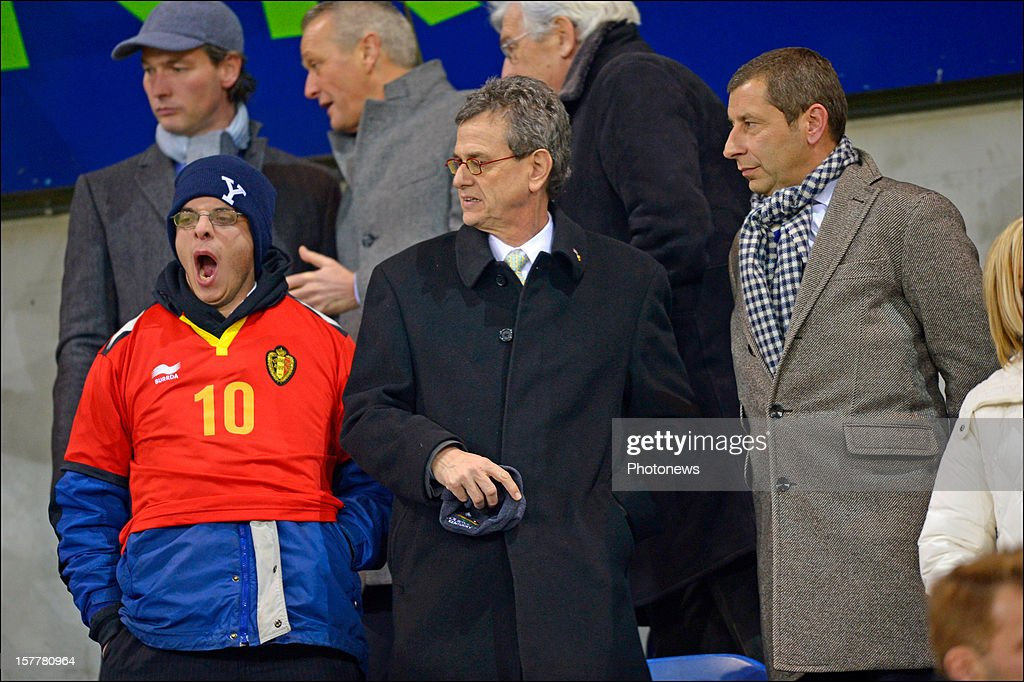 American ambassador in Belgium Howard Gutman (C) with his son (L) during the UEFA Europa League group G match between KRC Genk and FC Basel 1893 at the Cristal Arena stadium on December 06, 2012 in Genk, Belgium.