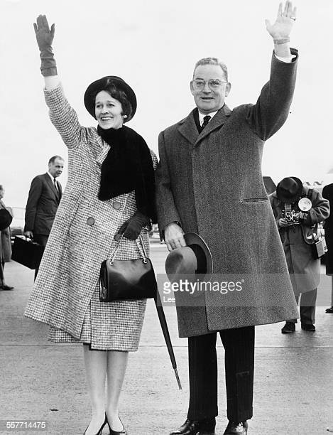 American Ambassador to Britain John 'Jock' Hay Whitney and his wife Betsey waving farewell to the UK bound for home at London Airport January 14th...