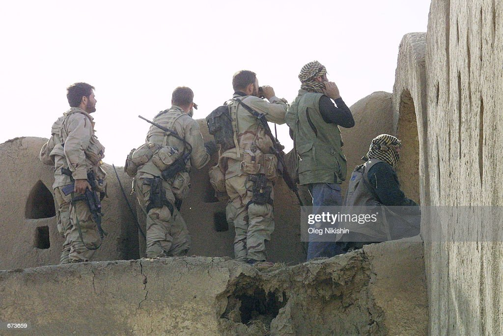 American and British special operations soldiers observe fighting between Northern Alliance troops and proTaliban forces November 27 2001 in a...