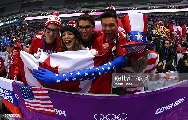 American and Canadian fans attend the Ice Hockey Women's Gold Medal Game between Canada and the United States on day 13 of the Sochi 2014 Winter...