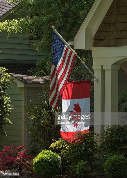 American and Canadian flags on one house Charlotte North Carolina on April 24 2015
