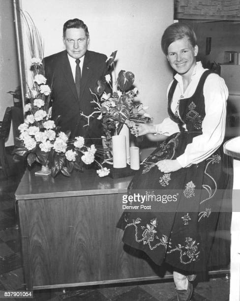 American and European Floral Arrangements Compared Anne Margrethe Linderoth of Norway displays a European floral arrangement of red anthurium yellow...