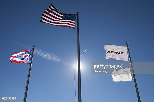 American and Honda Motor Co flags fly at the Honda Auto Plant in Marysville Ohio US on Thursday Nov 10 2016 Honda Motor Co plans to recalibrate...