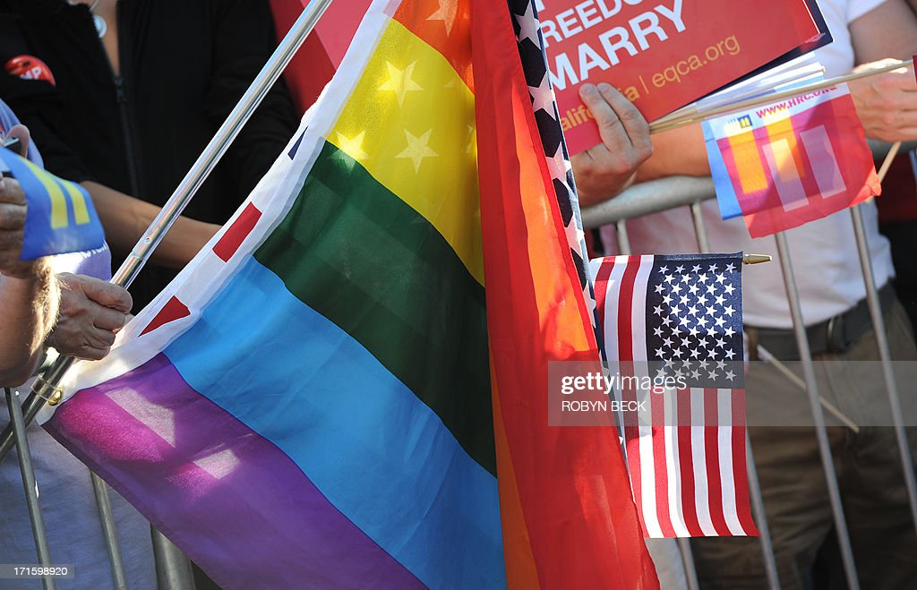 American and Rainbow flags are seen at a rally celebrating the Supreme Court rulings regarding samesex marriage June 26 2013 in West Hollywood...
