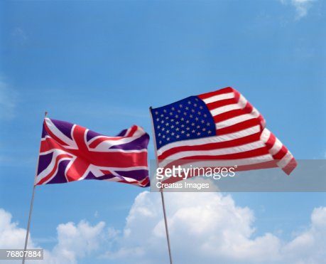 American and UK flags flying together : Stock Photo
