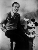 American animator and producer Walt Disney with one of his creations Mickey Mouse