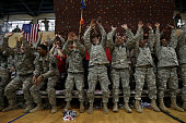 American Armed Forces personel do the wave while watching the game between the Georgetown Hoyas and the Oregon Ducks during the Armed Forces Classic...