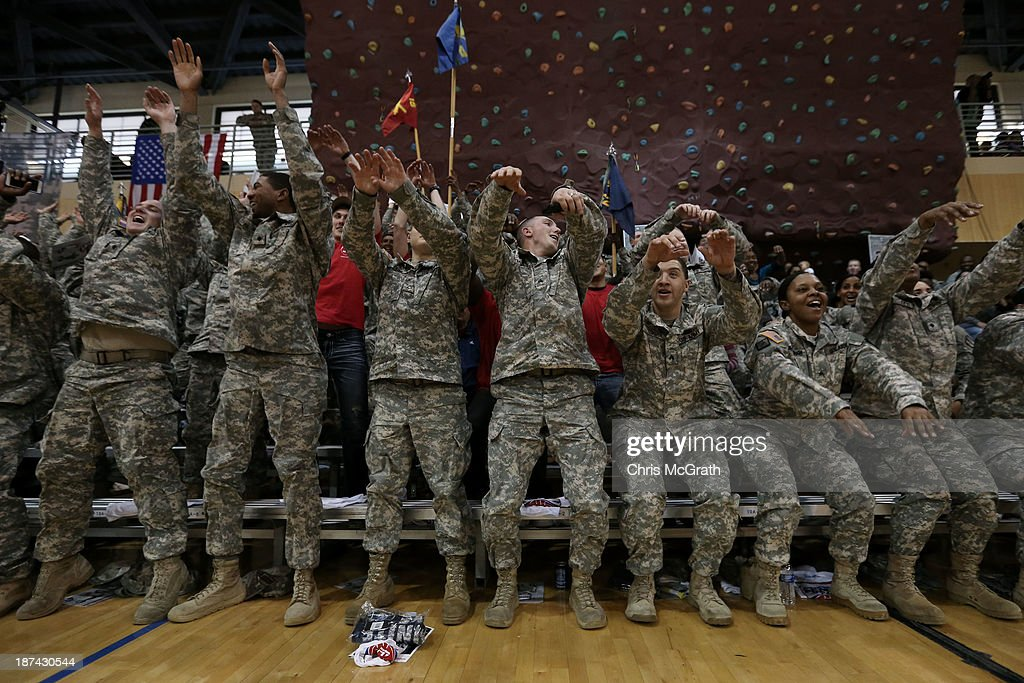 American Armed Forces personel do the wave while watching the game between the Georgetown Hoyas and the Oregon Ducks during the Armed Forces Classic at United States Army Garrison-Humphreys on November 9, 2013 in Pyeongtaek, South Korea.