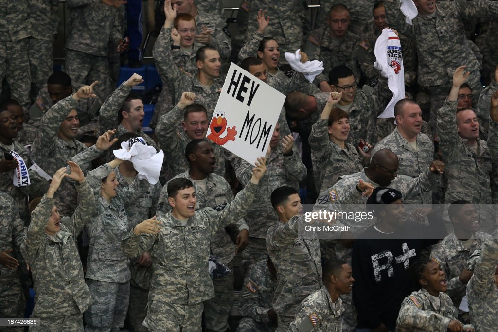 American Armed Forces personnel cheer and wave signs ahead of the start of the game between the Georgetown Hoyas and the Oregon Ducks during the Armed Forces Classic at United States Army Garrison-Humphreys on November 9, 2013 in Pyeongtaek, South Korea.