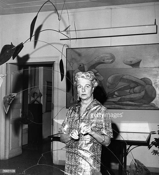 American art collector and millionairess Peggy Guggenheim in her eighteenth century Venetian palace Hanging from the ceiling is a 1941 Alexander...