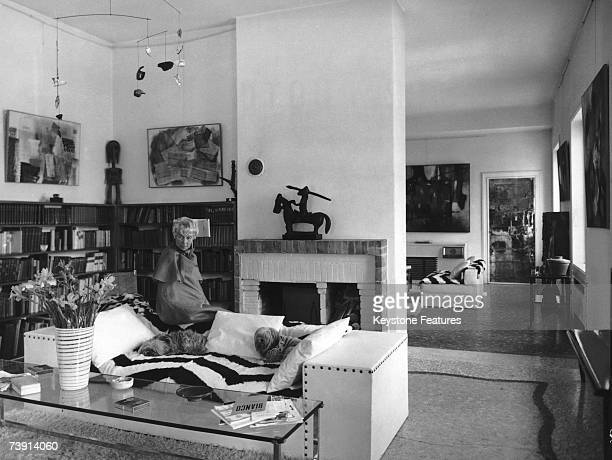 American art collector Peggy Guggenheim at her home in Venice with her dogs December 1961