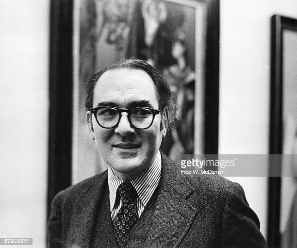 American art critic and essayist Hilton Kramer smiles as attends an exhibit Max Ernst's works New York New York February 12 1975