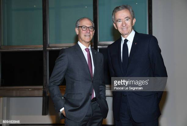 American art historian and director of the Museum of Modern Art in New York City Glenn D Lowry and CEO of LVMH Group Bernard Arnault attend 'Etre...
