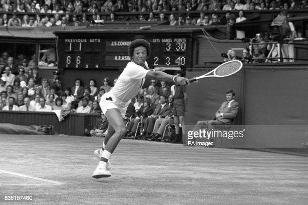 American Arthur Ashe as he strove against the third set counter attack of reigning champion Jimmy Connors during the Wimbledon Men's Single...