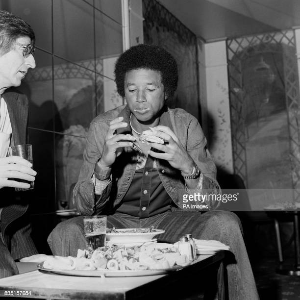 American Arthur Ashe celebrated with a hamburger at his hotel after defeating Jimmy Connors to win the Wimbledon Men's Single Competition