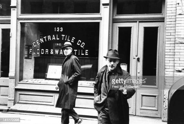 American artist and abstract expressionist Clyfford Still walks past the Central Tile Company's storefront on West 24th Street New York New York...