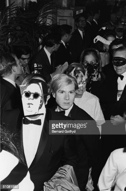 American artist and Andy Warhol arrives at Truman Capote's Black and White Ball in the Grand Ballroom of the Plaza Hotel New York New York November...