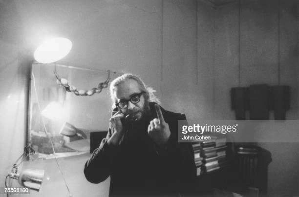 American artist and archivist Harry Everett Smith gestures as he talks on the telephone in a room at the Chelsea Hotel New York New York 1969