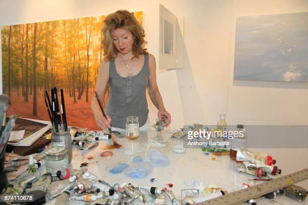American artist April Gornik mixes paints in her studio Sag Harbor New York 2011