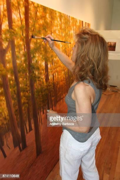 American artist April Gornik works on a large painting in her studio Sag Harbor New York 2011