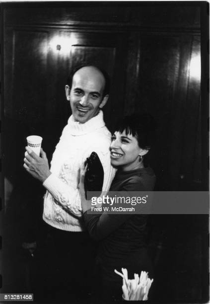 American artist author choreographer theater director Abraham Remy Charlip and poet magazine editor Hettie Cohen Jones smile as they attend a party...